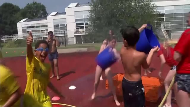 uk experiences second hottest day on record england london croydon ext schoolchildren in bathing costumes sprayed with water hose at summer activity... - heatwave stock videos & royalty-free footage