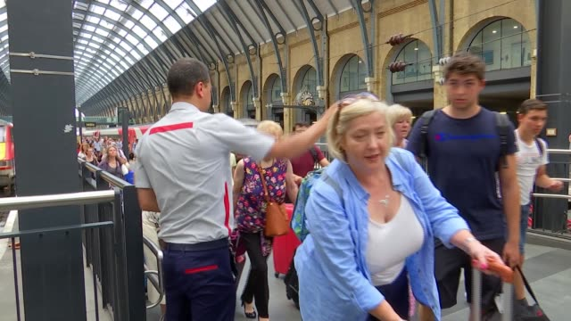 experiences second hottest day on record; uk, england, london; various of people at train station, kate mcferran interview and dr lynn thomas... - sweat stock videos & royalty-free footage