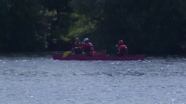 warnings over danger of swimming in open waters england gloucestershire long shot boat police and ambulance by river - gloucestershire stock videos and b-roll footage
