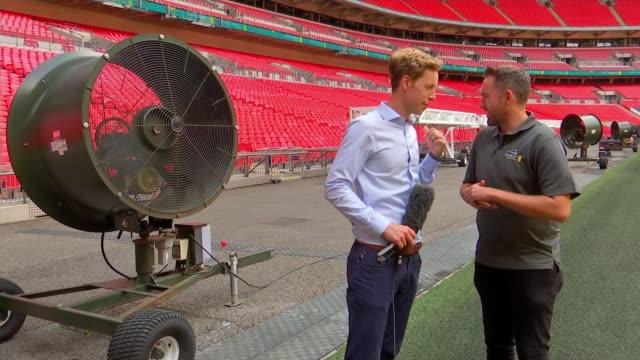 wembley stadium attemping to prepare grass for upcoming season; uk, london, wembley stadium: head groundsman interview, wembley arch, fans, grass... - グランドキーパー点の映像素材/bロール