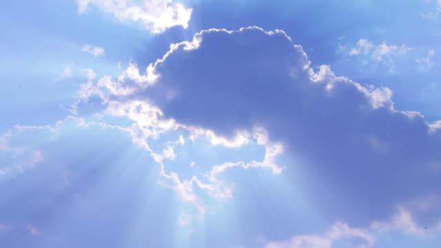 heavenly clouds with sun rays one of 2 hd1080p24fps - sunbeam stock videos and b-roll footage
