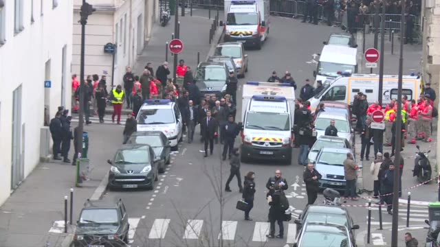 heavily armed gunmen shouting islamist slogans stormed a paris satirical newspaper office wednesday and shot dead at least 12 people in the deadliest... - materiale cartaceo video stock e b–roll