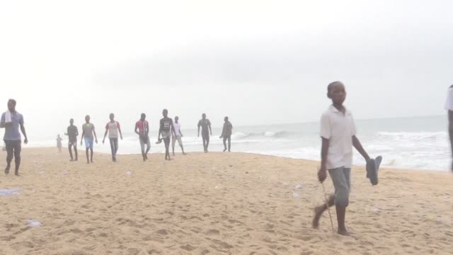 heavily armed men gunned down 16 people at an ivory coast resort sunday in an attack claimed by an al qaeda affiliate leaving bodies strewn on the... - côte d'ivoire stock videos & royalty-free footage