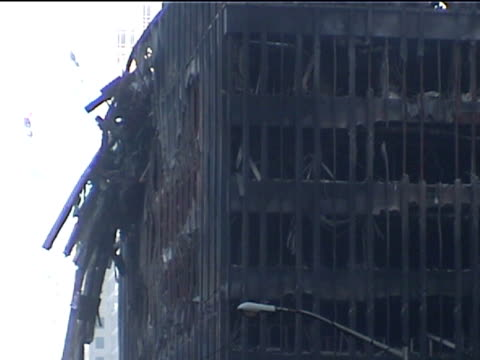 a heavily damaged and burned out wtc building 5 in the aftermath of the 9/11 terrorist attacks in downtown manhattan - september 11 2001 attacks stock videos & royalty-free footage