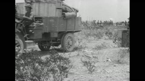 vídeos de stock e filmes b-roll de heavily loaded flatbed truck with soldiers and their belongings drives away from cars of a passenger train / soldiers watch as a loaded truck rolls... - corpo de fuzileiros da marinha americana