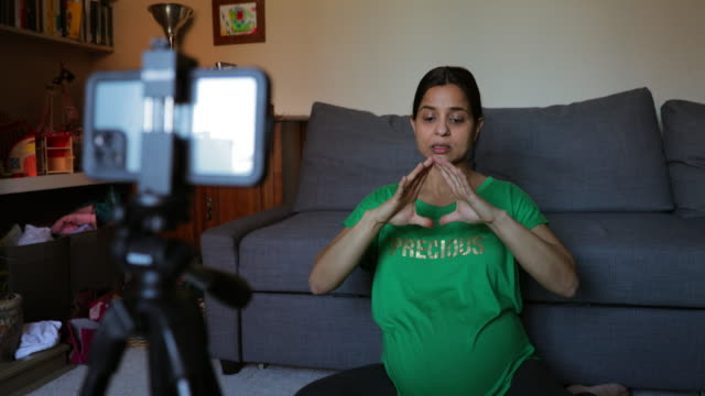 heavily pregnant woman vlogging - freelance work stock videos & royalty-free footage