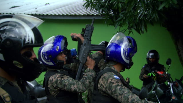 Heavily-armed and protected military police in San Pedro Sula in Honduras set off for patrol in various vehicles.