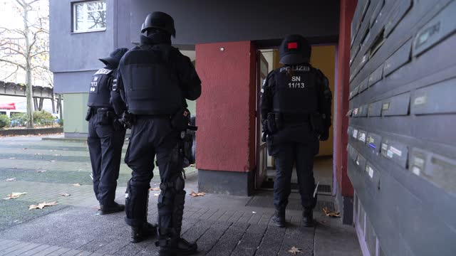 heavily-armed police stand in the doorway of an apartment building in kreuzberg district during raids in which police arrested three suspects in... - doorway stock videos & royalty-free footage