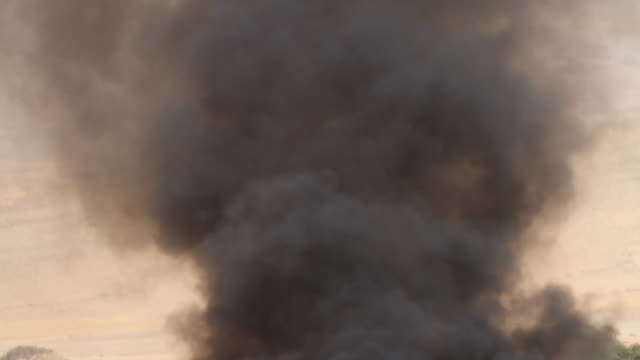 heavy black smoke from a burning truck