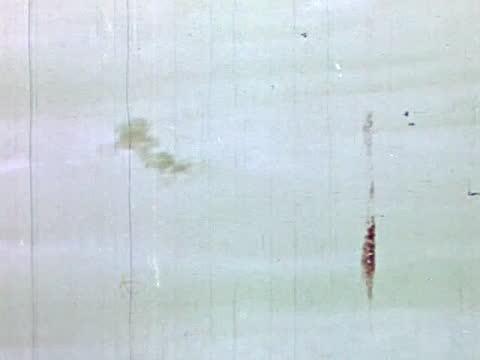 vídeos de stock, filmes e b-roll de heavy bomber crew during air raid/ puffs of smoke in the sky - air raid