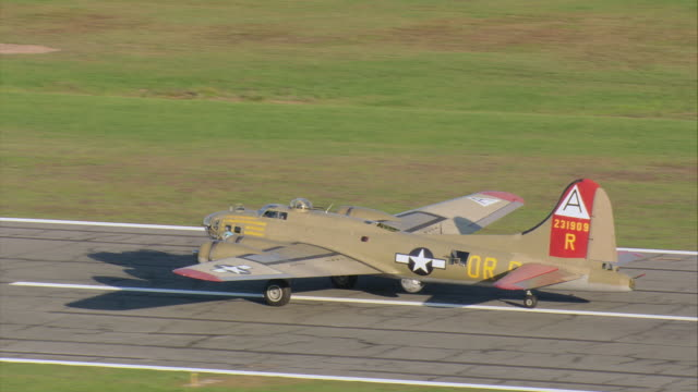aerial b-17 heavy bomber taking off at regional airport / new bedford, massachusetts, united states - bomber plane stock videos and b-roll footage