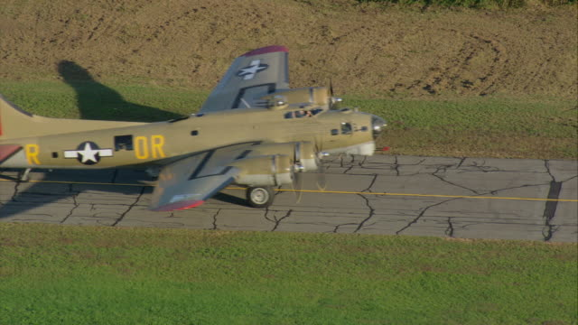 aerial b-17 heavy bomber taxiing on runway of regional airport / new bedford, massachusetts, united states - bomber plane stock videos and b-roll footage