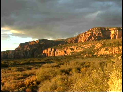 ms, heavy clouds above rock formation, zion national park, utah, usa - stationary process plate stock videos & royalty-free footage