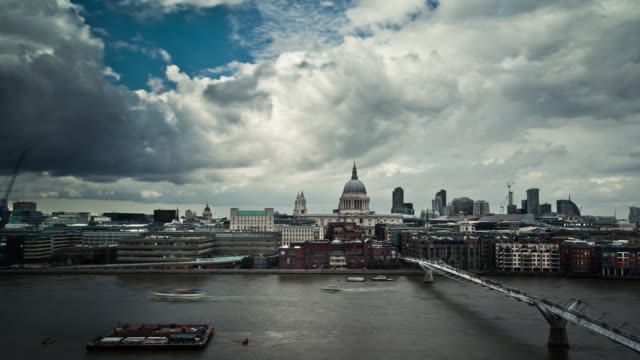 heavy clouds billow over london, england. - london millennium footbridge stock videos & royalty-free footage