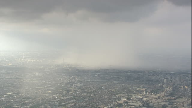 heavy clouds dump rain over tokyo. - wispy stock videos and b-roll footage