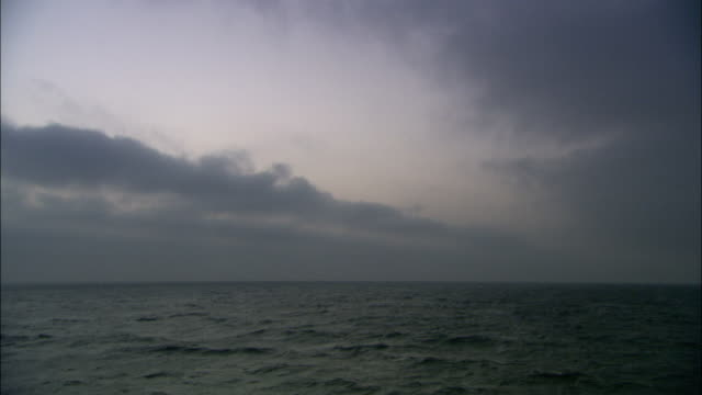 Heavy clouds gather on the Mediterranean horizon. Available in HD.