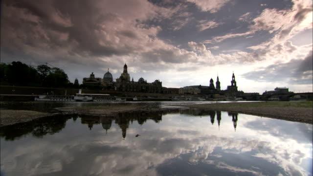 vídeos de stock, filmes e b-roll de heavy clouds loom over dresden germany. available in hd. - rio elbe