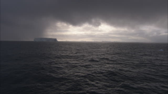 WS, Heavy clouds over sea with icebergs in distance, Antarctica
