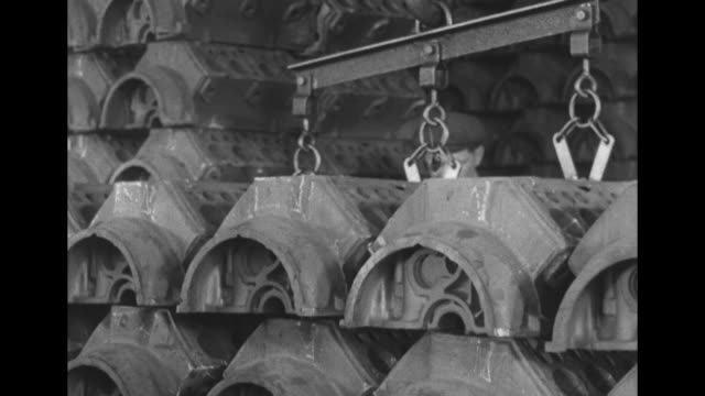 vs heavy crucible with molten metal being poured man looks through a viewfinder crankshafts being moved from sand casting engine blocks being lowered... - piston stock videos & royalty-free footage