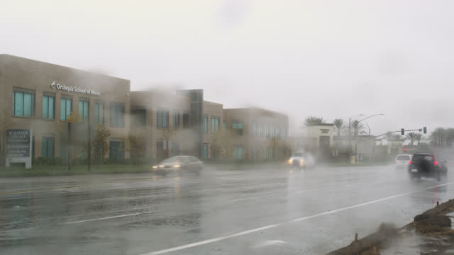 heavy downpour in irvine, southern california, united states - irvine verwaltungsbezirk orange county stock-videos und b-roll-filmmaterial