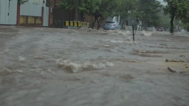 heavy downpours hit downtown asuncion, the rainfall caused flooding in several streets on 3 may, 2017 in paraguay's capital. - south america stock videos & royalty-free footage