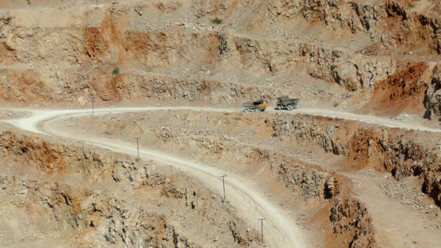 heavy dump trucks on the road in a career - surface mine stock videos and b-roll footage