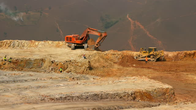heavy duty vehicles at a gold mine, drc - construction vehicle stock videos & royalty-free footage