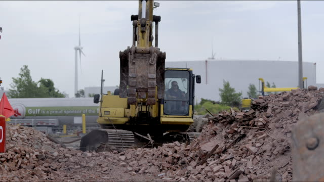 heavy equipment grappling arm moves and sorts scrap pile debris for recycling in junk yard. - bulldozer stock videos and b-roll footage