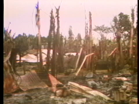heavy fighting with the viet cong left phong am village in south vietnam totally destroyed. - south vietnam stock videos & royalty-free footage
