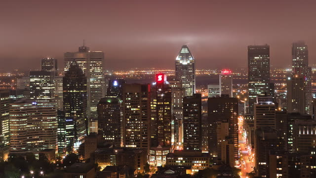 WS T/L Heavy fog rolls on Downtown Montreal at Dawn / Montreal, Quebec, Canada