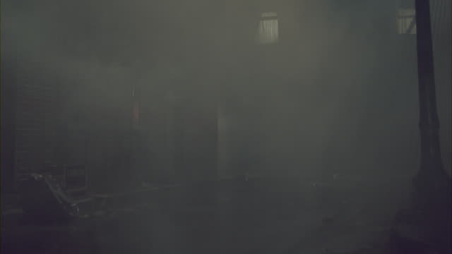 heavy fog rolls through an alley next to a brick apartment building in new york. - alley stock videos & royalty-free footage