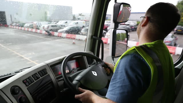 heavy goods vehicle learner driver simon peters driving a truck on a parking lot during a training session at gtg training in wolverhampton, uk on... - vehicle interior stock videos & royalty-free footage