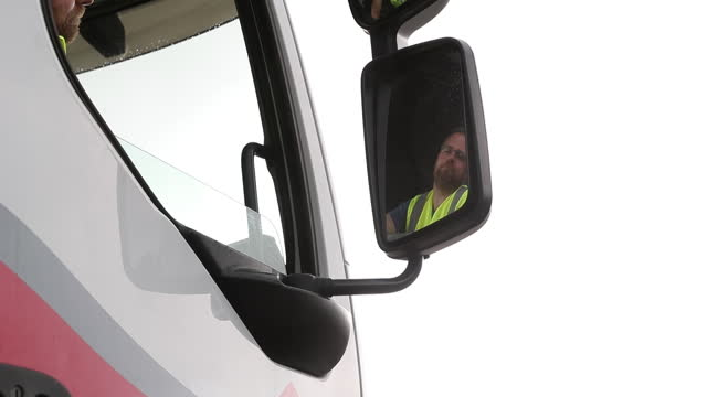 heavy goods vehicle learner driver simon peters reflected in a truck side view mirror during a training session at gtg training in wolverhampton, uk... - mirror stock videos & royalty-free footage