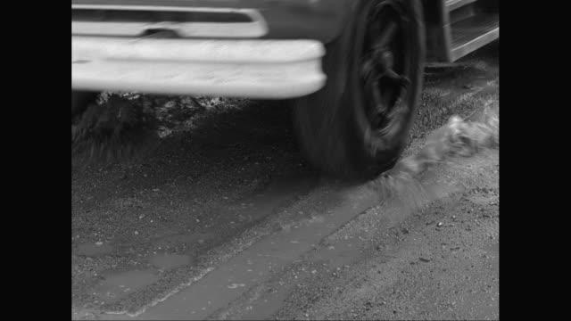 CU Heavy goods vehicles moving on mud / United States