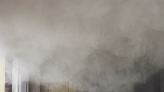 vídeos de stock, filmes e b-roll de heavy gray smoke filling the upper portion of a room in a burning house - artbeats