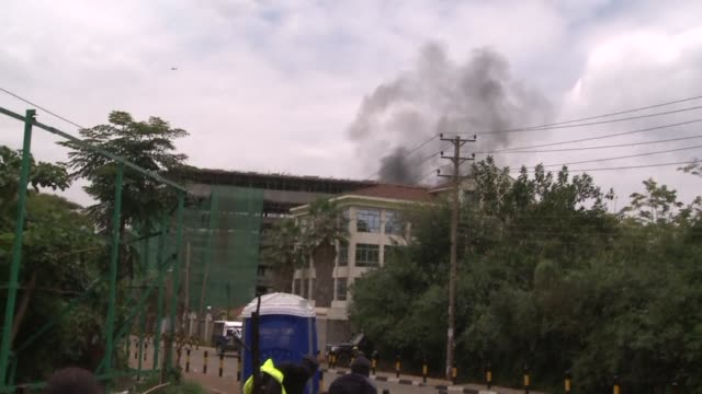 heavy gunfire and loud explosions erupted at nairobis westgate shopping mall monday as kenyan troops fought al qaeda linked gunmen who were holding... - 2013 stock videos & royalty-free footage