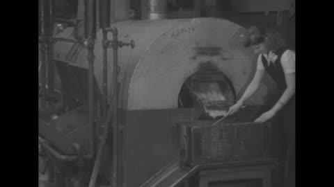 vídeos y material grabado en eventos de stock de heavy guns and cannons firing / scores of women in summer attire at factory / aerial pan of interior of factory / vs women seated at workstations... - cucharón