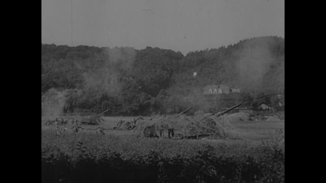 vidéos et rushes de heavy guns firing from underneath camouflage netting / shells exploding / note: exact day not known - world war ii