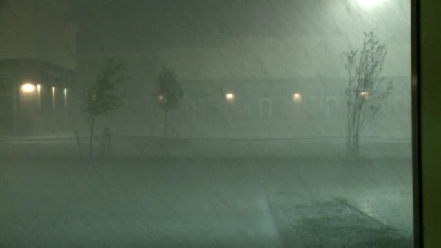 MONTAGE ZI Heavy hail falling on rooftop and parking lot at night / Dallas, Texas, USA