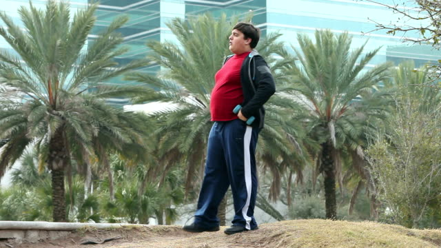 heavy hispanic man jogging with hand weights - obesity stock videos and b-roll footage