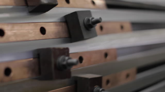 heavy industry - manufacturing - close up of a jig holding slats on a large, machined, manufactured object - bolt stock videos & royalty-free footage