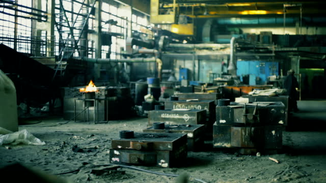 heavy industry. workers in old foundry - foundry stock videos & royalty-free footage