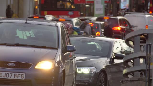 heavy london traffic at rush hour dusk cars passing camera traffic lights jam - road stock videos & royalty-free footage