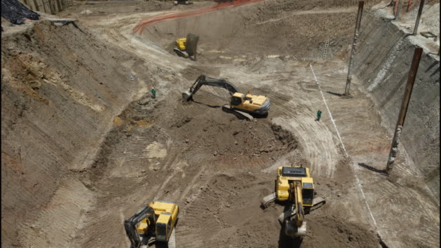 heavy machinery being used for land excavation view of construction site on sao paulo, brazil - construction machinery stock videos & royalty-free footage