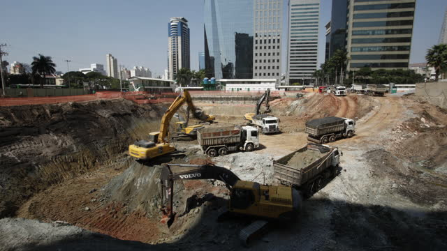 heavy machinery being used for land excavation view of construction site on sao paulo, brazil - construction vehicle stock videos & royalty-free footage