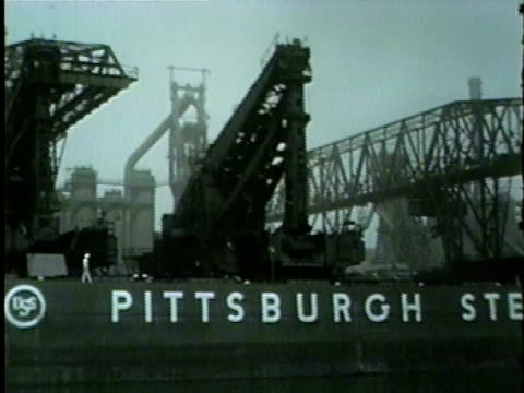 heavy machinery moving on pittsburgh steamship co. ships in gary, indiana in 1954. - indiana stock videos & royalty-free footage