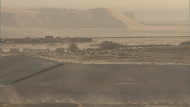 heavy machinery operates at a landfill. - rubbish dump stock videos & royalty-free footage