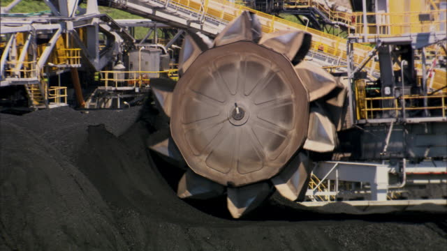 heavy machinery scoops up coal at the hay point services coal terminal. - coal stock videos & royalty-free footage
