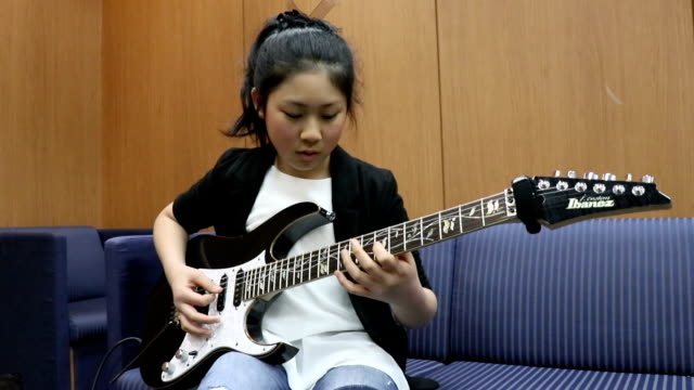 Heavy metal guitarist LisaX a 12 yearold enrolled in an elementary school in Kanagawa Prefecture shows off the axe skills that have earned her name...