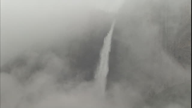 heavy mist drifts around bridalveil fall in yosemite national park. - bridal veil falls yosemite stock videos & royalty-free footage